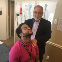 Dr. Pizza with chiropractic patient