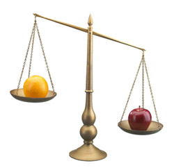 Scale weighing an apple and an orange